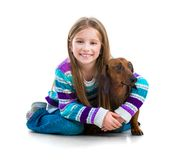 Happy little girl with her dachshund Royalty Free Stock Photography