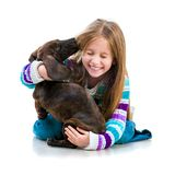 Happy little girl with her dachshund Stock Image