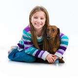 Happy little girl with her dachshund Stock Photos