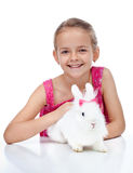 Happy little girl with her cute rabbit Royalty Free Stock Photo