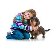 Happy little girl with her dachshund Royalty Free Stock Image