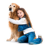 Happy little girl with her dog Royalty Free Stock Photo