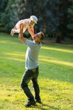 Happy little girl and her father Royalty Free Stock Photos
