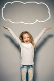 Happy little girl with her hands up Royalty Free Stock Photo