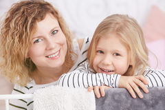 Happy little girl and her mom Royalty Free Stock Photos
