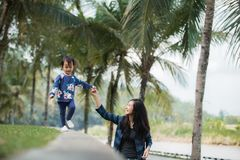 Happy little girl with her mom walking Royalty Free Stock Photography