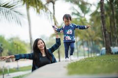 Happy little girl with her mom walking Stock Image