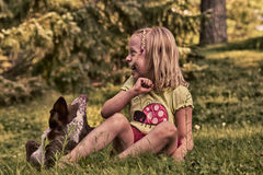 Happy Little Girl and Her Pet Royalty Free Stock Image