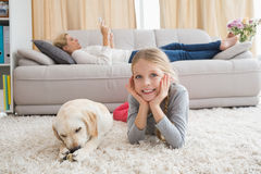 Happy little girl with her puppy Royalty Free Stock Photography