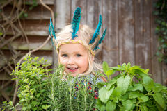 Happy little  girl with herbs Stock Images