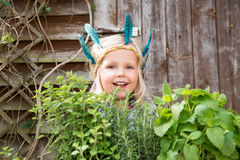 Happy little  girl with herbs Stock Photos