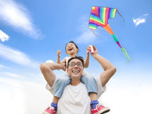 Happy little girl on his father shoulder Royalty Free Stock Photo