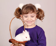 Happy little girl hold bunny Royalty Free Stock Image