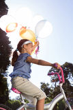 Happy little girl holding balloons Royalty Free Stock Photos
