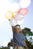 Happy little girl holding balloons Royalty Free Stock Photography