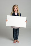 Happy little girl holding a blank sign royalty free stock images
