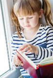 Happy little girl holding a book Royalty Free Stock Photo