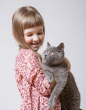 Happy little girl holding  a cat Stock Image