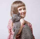 Happy little girl holding  a cat Royalty Free Stock Photo