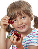 Happy little girl holding cherries Royalty Free Stock Images