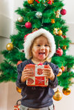 Happy Little Girl Holding a Christmas Gift Royalty Free Stock Image