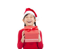 Happy little girl holding christmas gift Royalty Free Stock Image