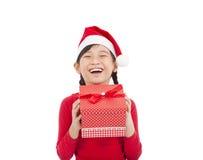 Happy little girl holding christmas gift. Happy asian little girl holding christmas gift Royalty Free Stock Image