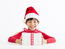 Happy little girl holding Christmas gift Royalty Free Stock Photography