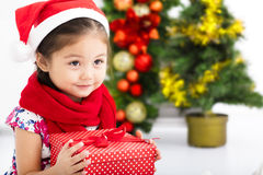 Happy little girl   holding Christmas gift Royalty Free Stock Images