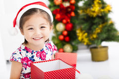 Happy little girl   holding Christmas gift Stock Images