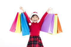 Happy little girl holding Christmas shopping bags Royalty Free Stock Image