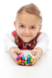 Happy little girl holding colorful modelling clay bars Royalty Free Stock Photos