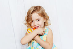 Happy little girl holding Easter eggs. Little girl holding Easter eggs royalty free stock image