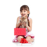 Happy little girl holding gift box with kitten Royalty Free Stock Photo