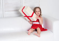 Happy little girl holding gift box Stock Photo