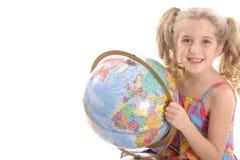 Happy little girl holding globe stock images