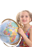 Happy little girl holding globe vertical. Photo of a happy little girl holding globe vertical Royalty Free Stock Photos