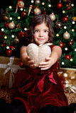 Happy little girl holding a heart Stock Photography