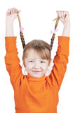 Happy little girl holding her pigtails. Isolated on white Royalty Free Stock Image