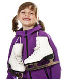 Happy little girl holding ice skates Stock Photos