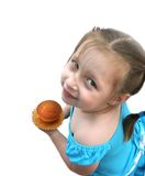 Happy little girl holding little cake. Little girl preparing too eat Stock Photos