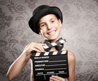 Happy little girl holding a movie clapper Royalty Free Stock Photography