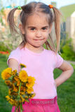 Happy little girl  holding out flowers Stock Images