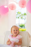 Happy Little Girl Holding Paper Pink Cup Stock Image