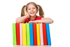 Happy Little girl holding pile of books. Isolated Stock Photos