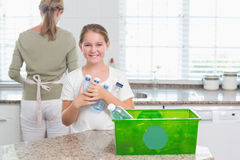 Happy little girl holding recycling bottles Royalty Free Stock Images