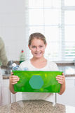 Happy little girl holding recycling box Royalty Free Stock Image
