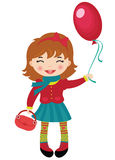 Happy little girl holding a red balloon Royalty Free Stock Photography