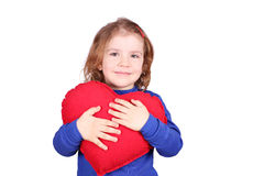 Happy little girl holding red heart Royalty Free Stock Images