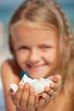 Happy little girl holding seashells - closeup Royalty Free Stock Image